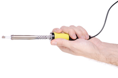 Soldering iron in hand on white background isolation