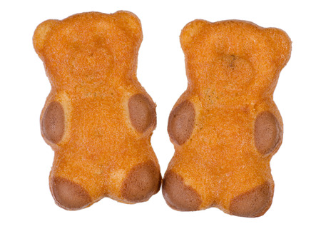 Biscuits in the form of a bear on a white background isolation Фото со стока