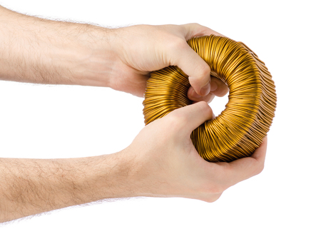 Transformer coil in hand on white background isolation