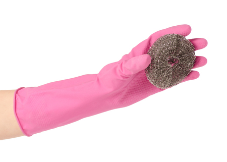 Hands in rubber gloves for cleaning metal brush for cleaning on a white background isolation Imagens