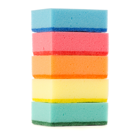 Kitchen sponges for washing dishes of different colors on a white background isolation