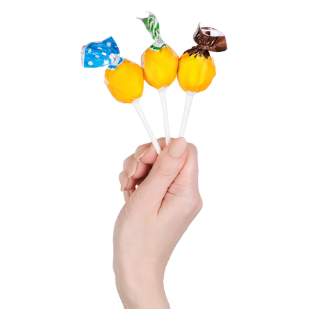 Lolipop in hand candy sweet on white background isolation Stock Photo