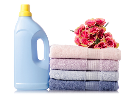 A stack set of towels pink blue flowers bottle for liquid laundry on a white background isolation Stock Photo