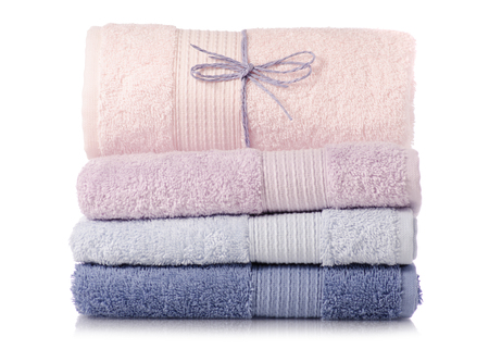 A stack of towels pink blue on a white background isolation