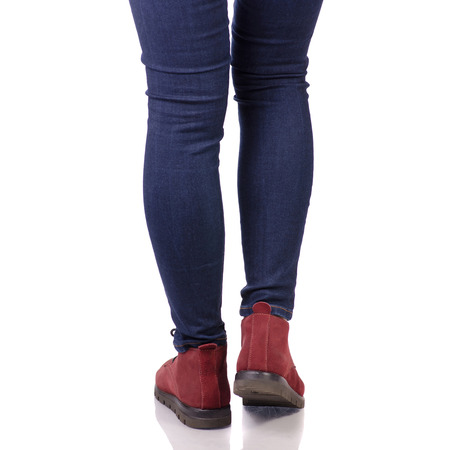 Female legs in jeans and in red suede shoes fashion beauty shop buy on white background isolation