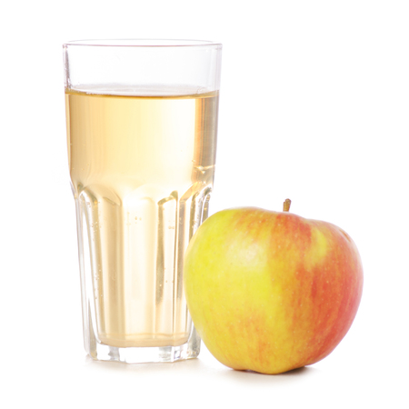 An apple besides a glass of apple juice isolated on white background Stockfoto