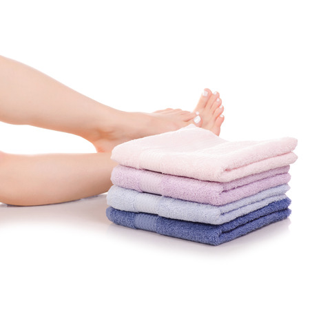 Female feet legs heels color bath towels beauty spa on a white background isolation