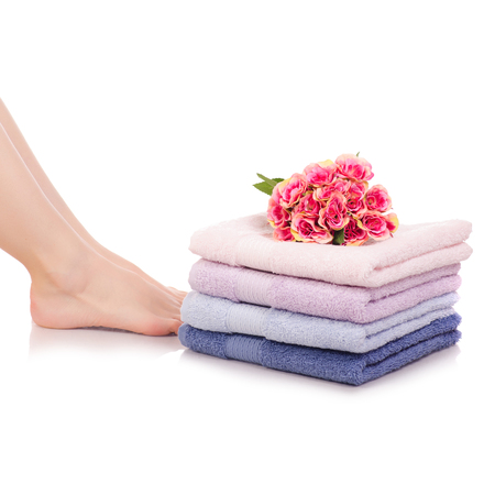 Female feet legs heels color bath towels flower beauty spa on a white background isolation Stock Photo