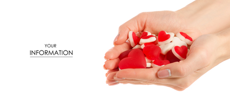 Jelly heart candies sweets in hand pattern on white background isolation Stock Photo