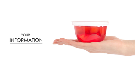 Cup of jelly with fruit red peach in hand pattern on white background isolation isolation