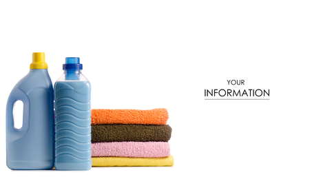 A stack of towels and launder a bottle of liquid powder conditioner softener pattern on a white background isolation Reklamní fotografie