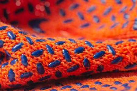 Orange working building gloves cloth macro blurred background