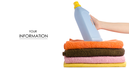 A stack of towels liquid powder for washing in hand pattern on a white background isolation