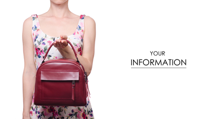 Woman in a dress in a hand a female leather red bag handbag pattern on a white background isolation