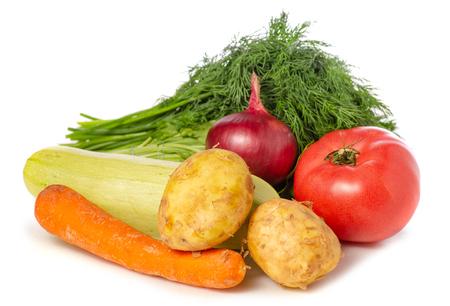 Greens vegetables zucchini tomato potatoes on a white background isolation Stok Fotoğraf