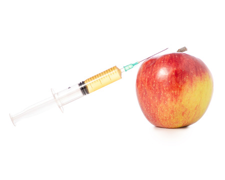 Syringe in apple on a white background isolation Archivio Fotografico