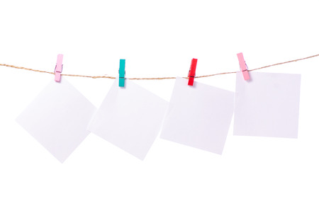 Sheet for notes clothespins rope on white background isolation