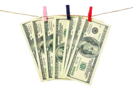 Money dollars clothespins rope on white background isolation