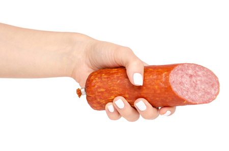 A smoked sausage in hand on a white background isolation