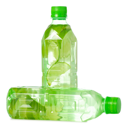 Two bottles of water with lime on white background isolation Banco de Imagens