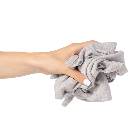 Crumpled gray shirt in hand clothes fabric on white background isolation 写真素材