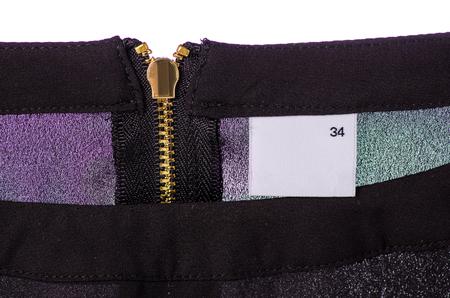 Size 34 textile clothes label lock on black background Imagens