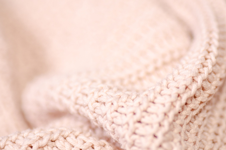 Beige knitted sweater texture fabric textile macro blur background