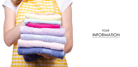 Woman in apron in hands stack towels laundry clothes pattern on white background isolation