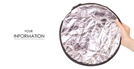 Small photo reflector in hand pattern on white background isolation