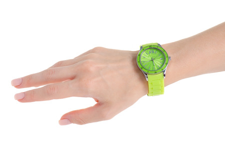 Green clock on a hand on a white background isolation Stock Photo