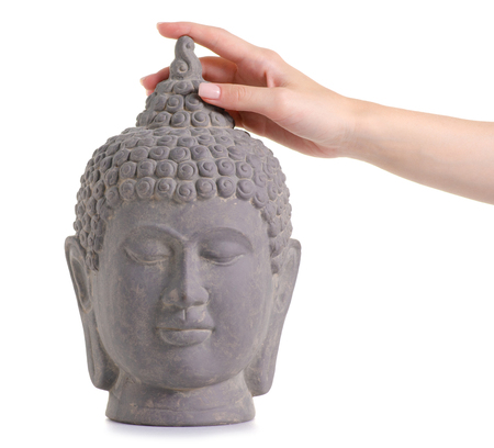 Clay head buddha in hand on white background isolation