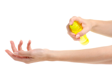 Bottle of a body spray in hand on a white background isolation