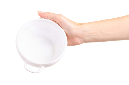 White soup plate in hand on white background isolation Standard-Bild