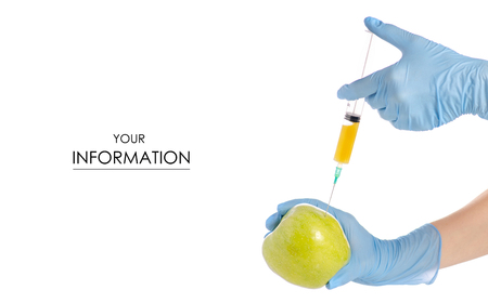 Syringe in the hands of an apple pattern on a white background isolation