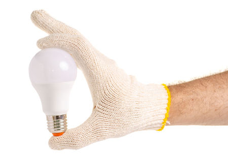 LED lamp in a hand on a white background isolation