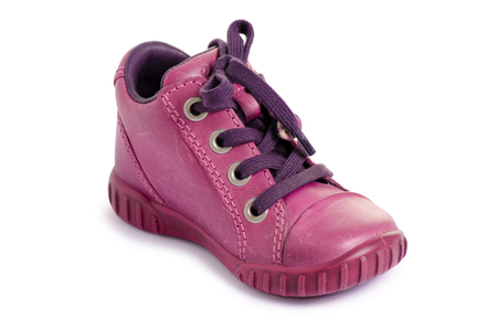Children's pink shoe on a white background isolation