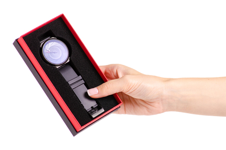 The black watch in a box in hand on a white background isolation