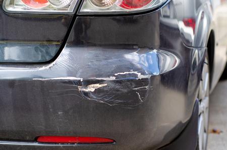 Black car dent rear bumper in the street broken Stock Photo