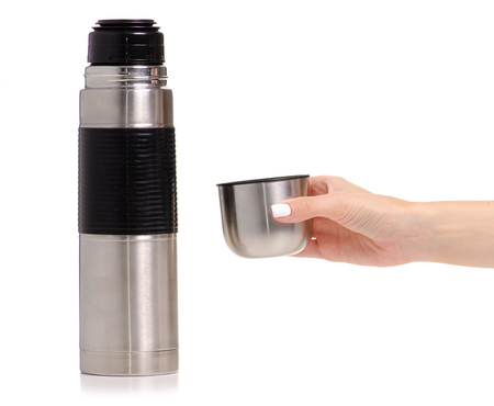 Thermos bottle metal in hand on white background isolation