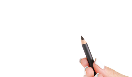 Black eye pencil in hand on white background isolation Stock Photo