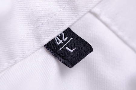 White shirt macro tag size L texture background