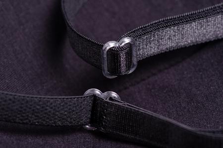 Soutien-gorge noir bretelles tissu matériel fond macro