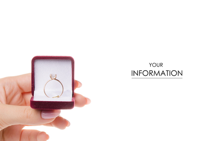 Gold ring in a box in a female hand pattern on a white background isolation