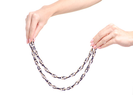 Jewelery bijouterie chain in hand on white background isolation