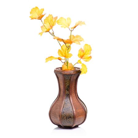 Wooden vase autumn leaves on white background isolation