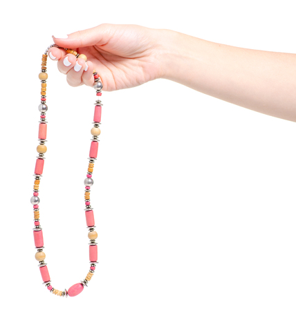 Beads stones accessory in hand on a white background isolation