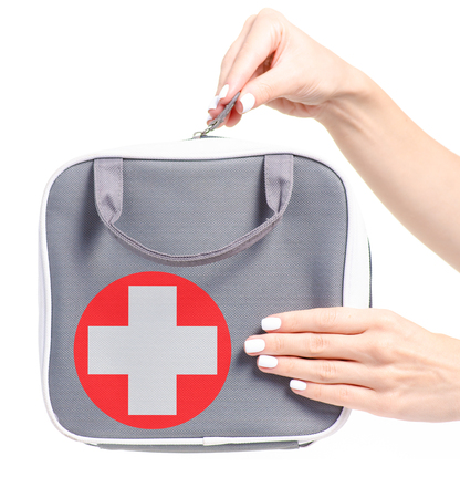First-aid kit bag in hand on a white background isolation