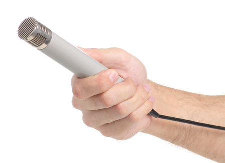 Microphone in hand isolated on a white background.