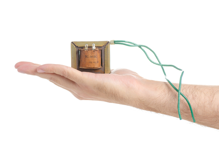 Electrical transformer power in hand isolated on a white background. Reklamní fotografie