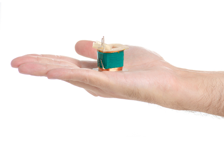 Electrical transformer power in hand on white background isolation